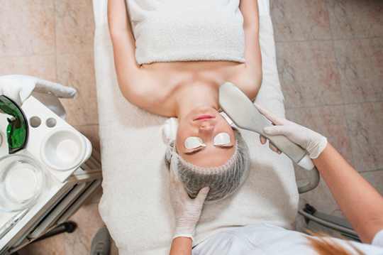 A woman receiving a BBL treatment