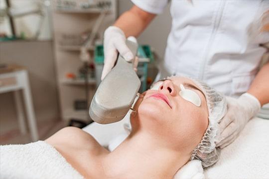 A woman getting a BBL treatment