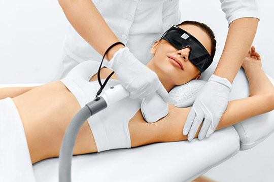 A woman getting laser hair removal treatment