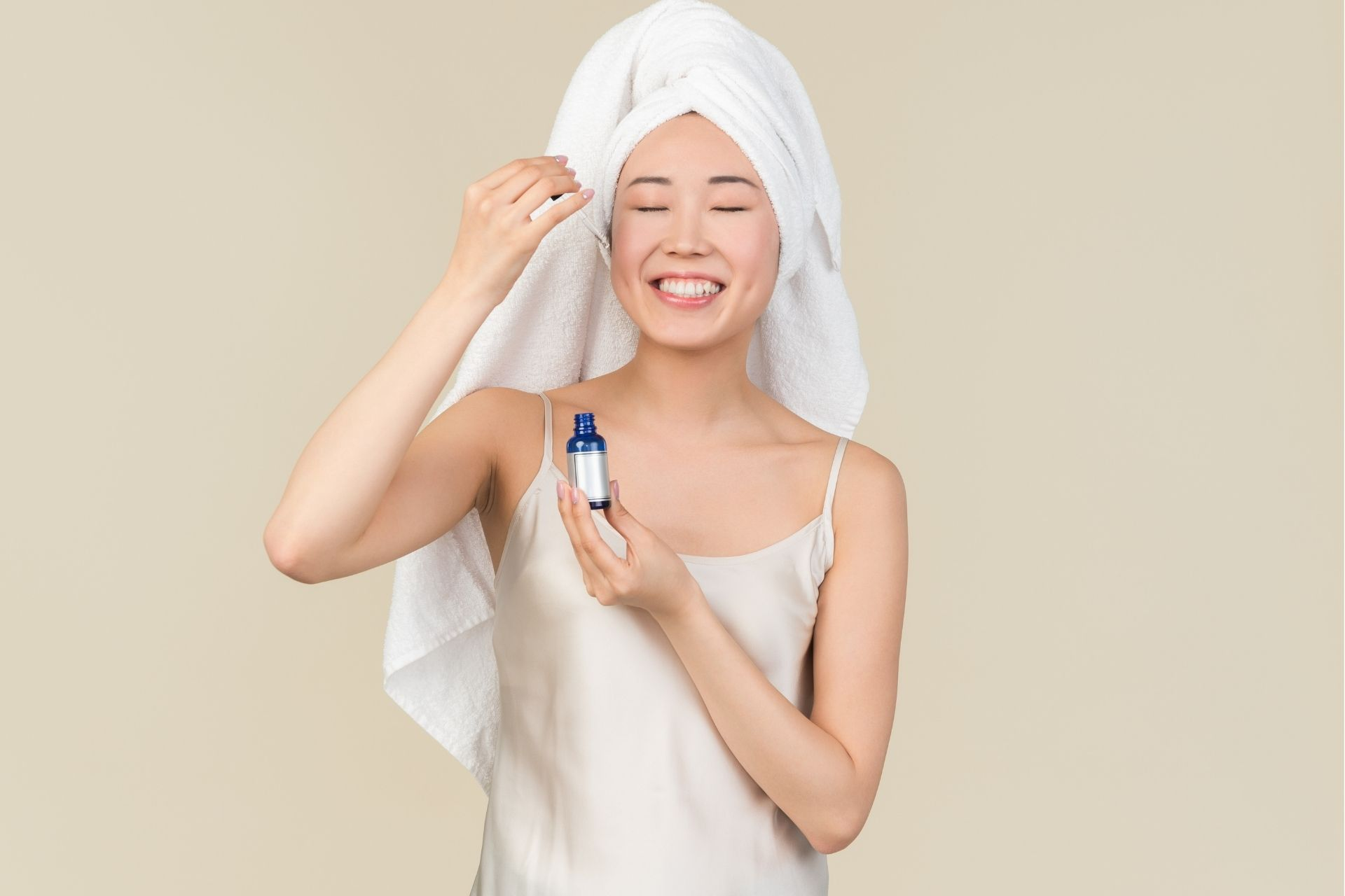 A person applying a medical grade skincare product onto her face