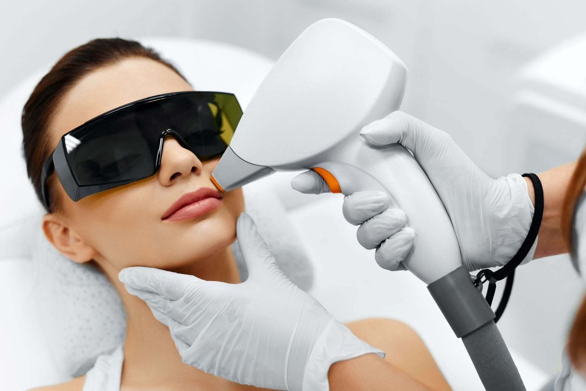 a person undergoing a laser hair removal procedure